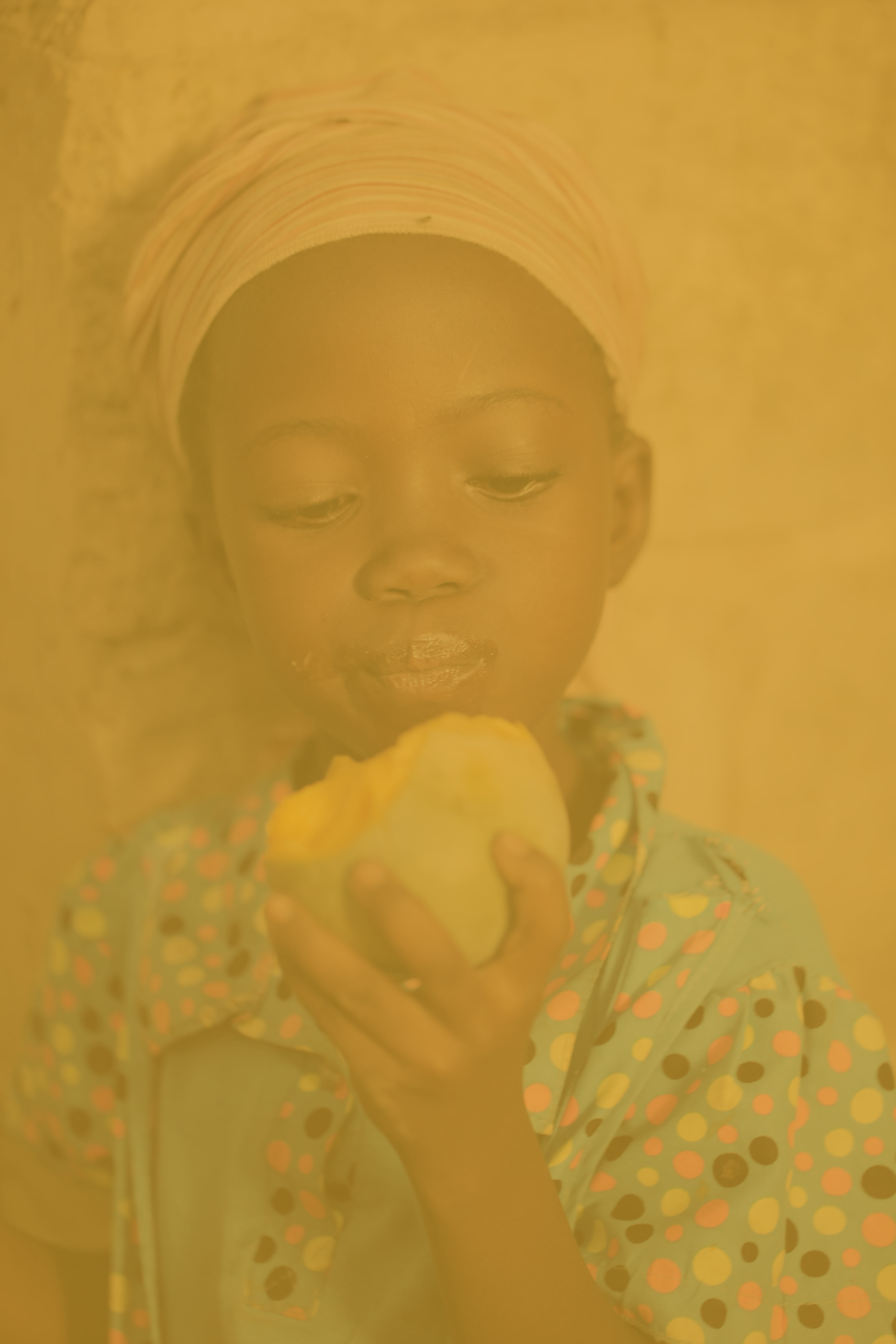Young girl looks at a piece of food