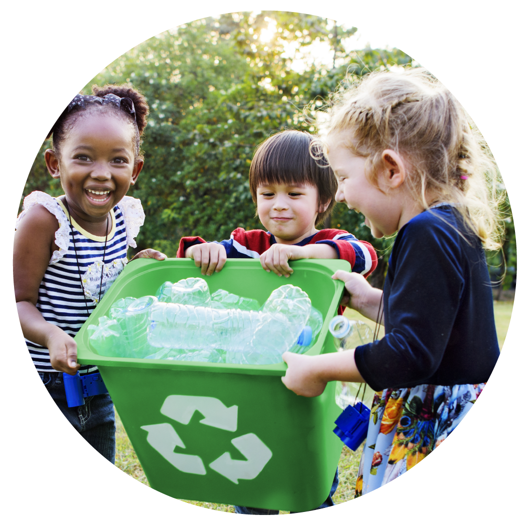 Children holding up a recycle box of plastic bottles