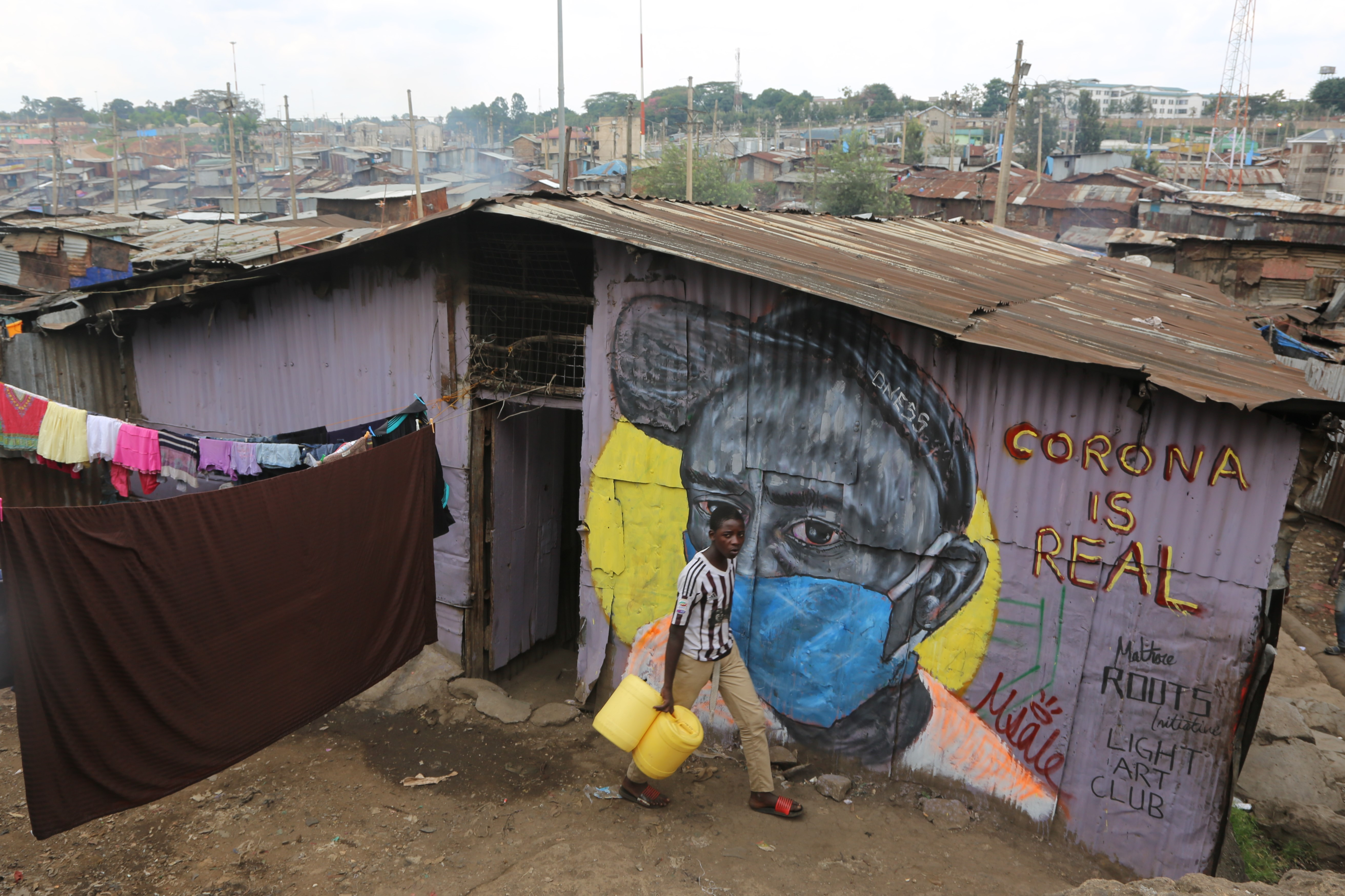 A mural in Nairobi's informal settlement of Mathare creating awareness of the importance of wearing masks to combat COVID-19