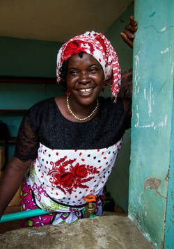 Mrs Mathilda Chonga, 47, Member of the community of Majengo, a slum village on the coast of Kenya; together with other widows the single mother of 6 kids runs a water kiosk in the slum