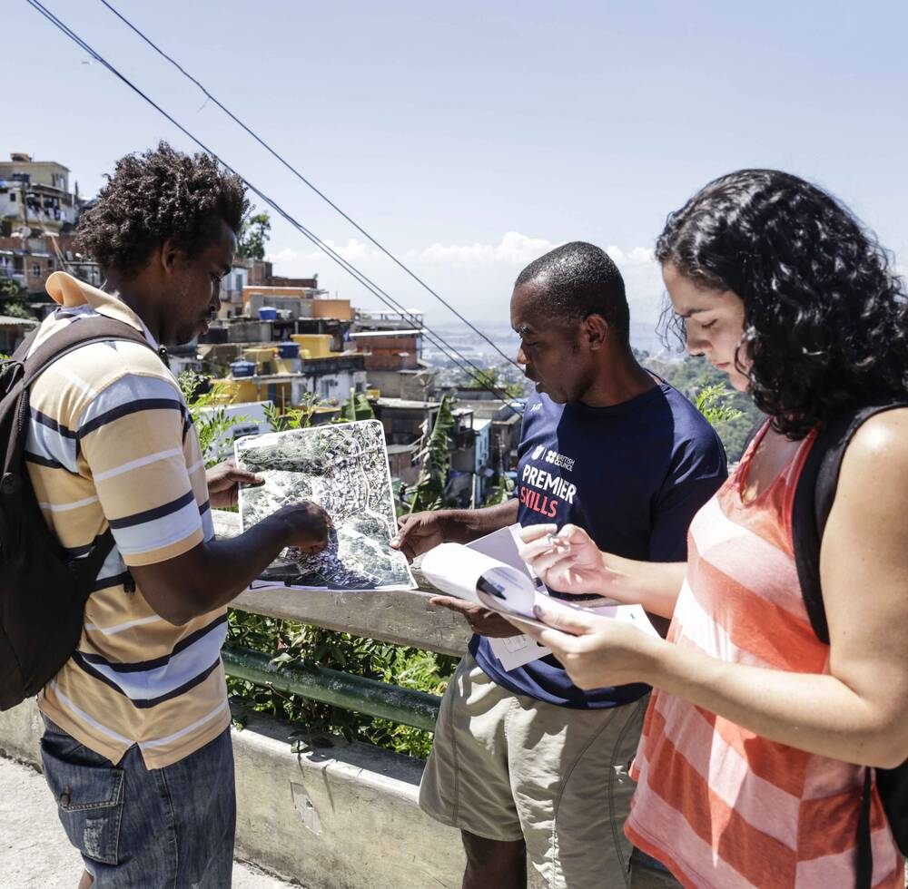 UN-Habitat consultants analyzing infrastructure conditions in a favela in Rio de Janeiro. Photo by Raphael Lima.