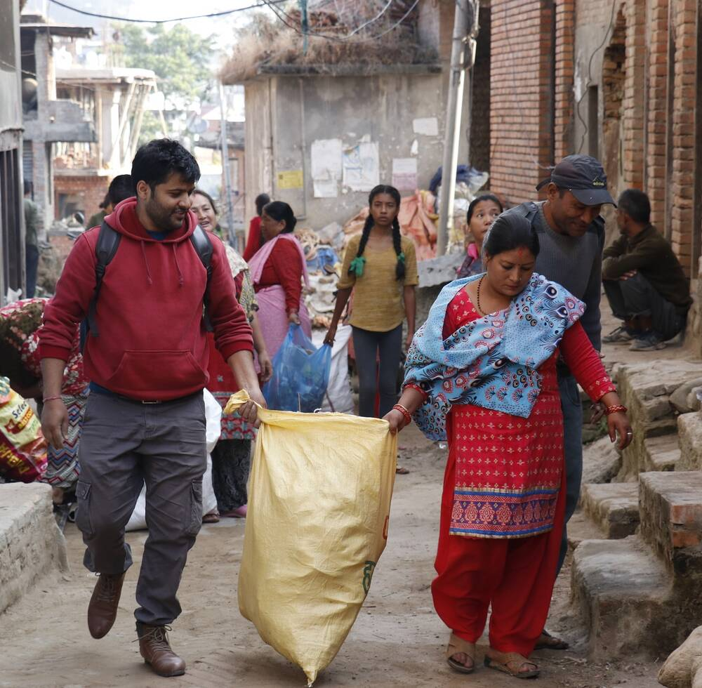 Junu Mijar, Ward Member, leading a cleaning campaign at Bungamati