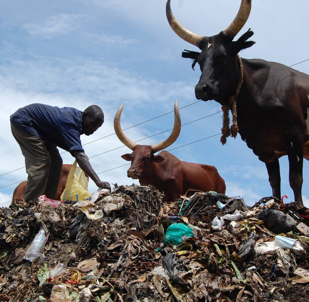 Man sorts garbage at Nakawa
