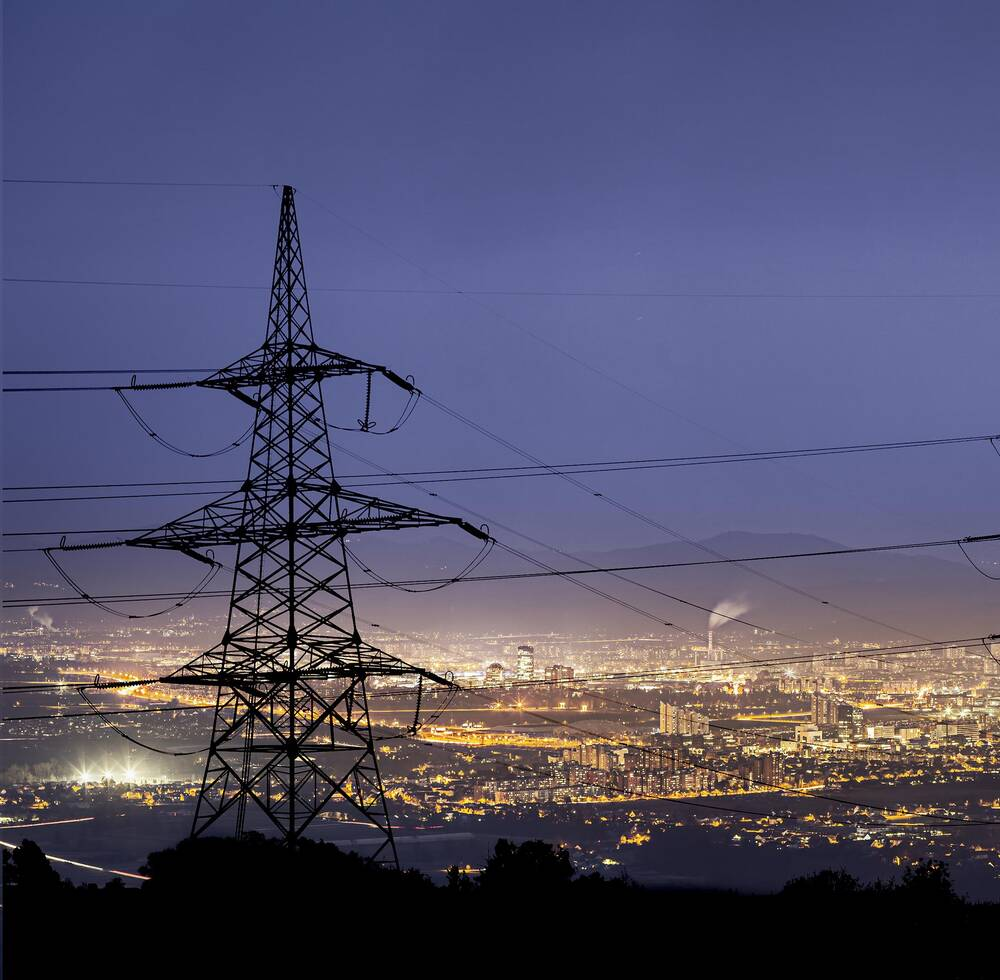 Electrical wires overlooking a city.