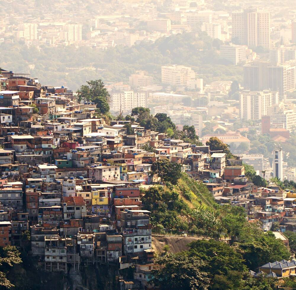 Small houses on a hill overlooking a city.