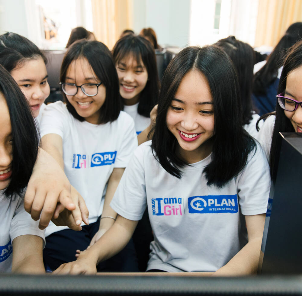 Girls in Hanoi participate in Plan International and UN-Habitat's joint workshop where they use Minecraft to redesign their aspects of their neighborhood to better include women.