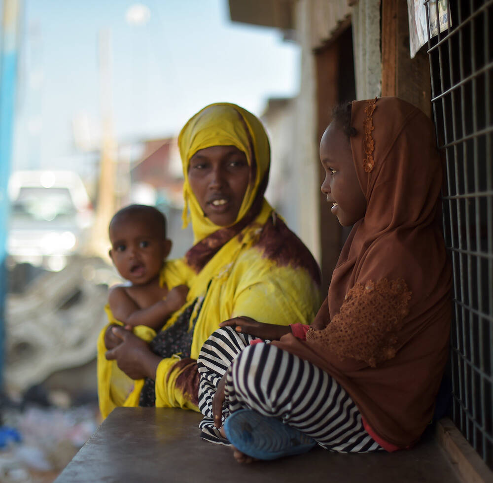 A mother speaks with her daughter on the outskirts of Mogadishu, Somalia, on March 6, 2017