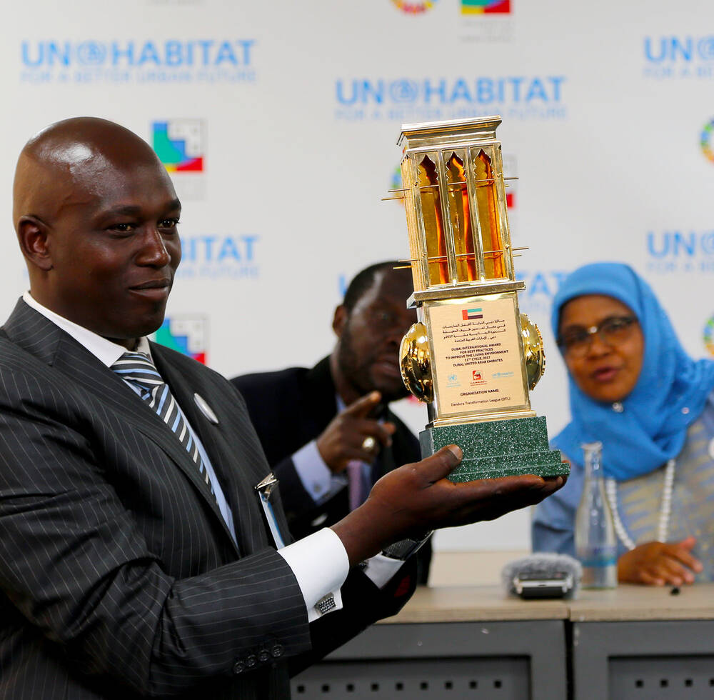 Dubai International Award winners for Best Practices Mr. Charles Gachanga display their trophy during the World habitat at the United Nations offices in Gigiri Nairobi, Kenya 2018
