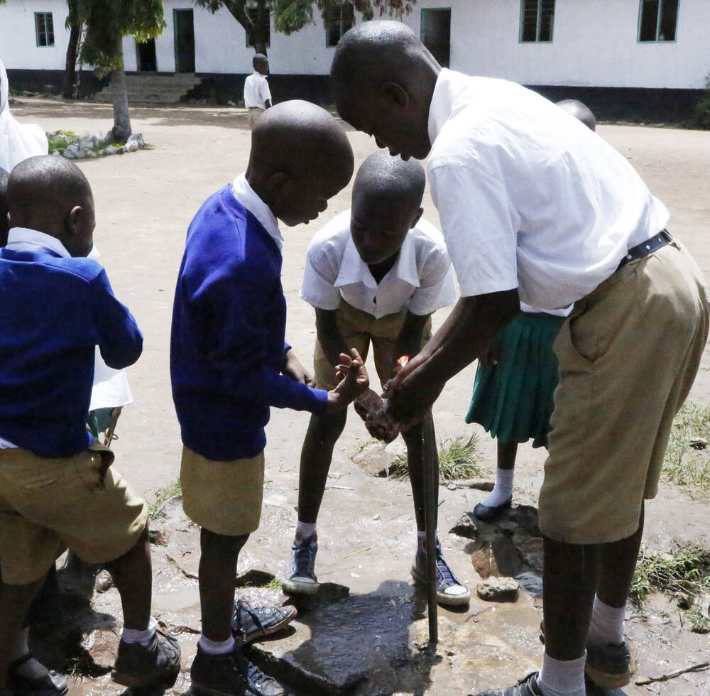 Kitangiri Primary school students at the water point.