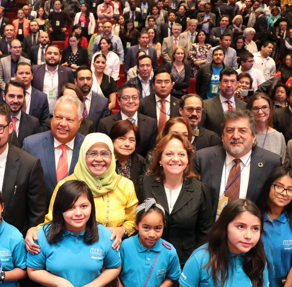 UN-Habitat Executive Director Maimunah Mohd Sharif with participants at the Global Observance of World Habitat Day 2019 in Mexico City, Mexico including a children's orchestra Rey Poeta