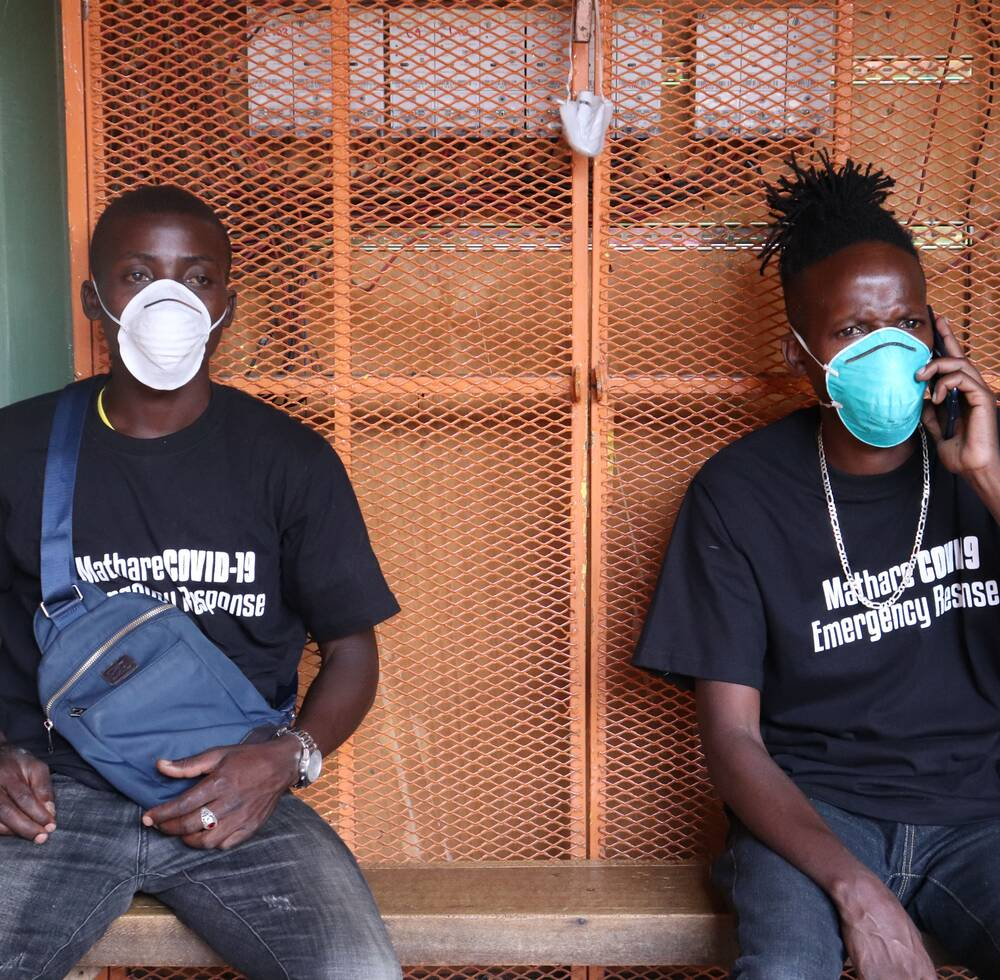 Two members of a youth-led organizations from the informal settlement of Mathare in Nairobi take part in training to oversee handwashing stations supported by UN-Habitat