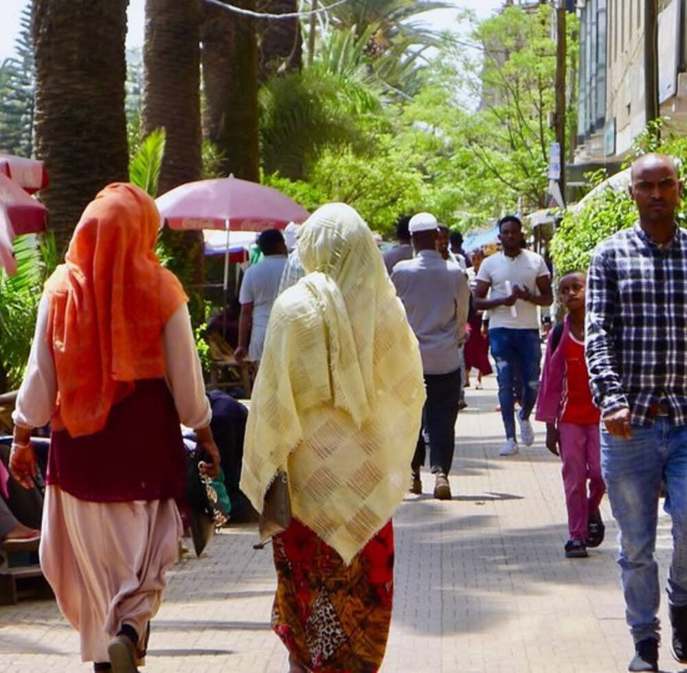 Pedestrians in Addis Ababa, Ethiopia enjoying a convenient and safe walkway