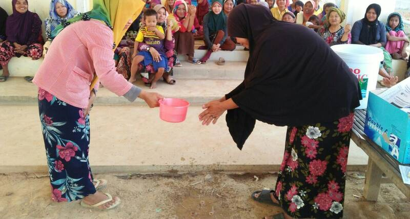 Families in Tboung Khmum district in Cambodia learn proper handwashing techniques