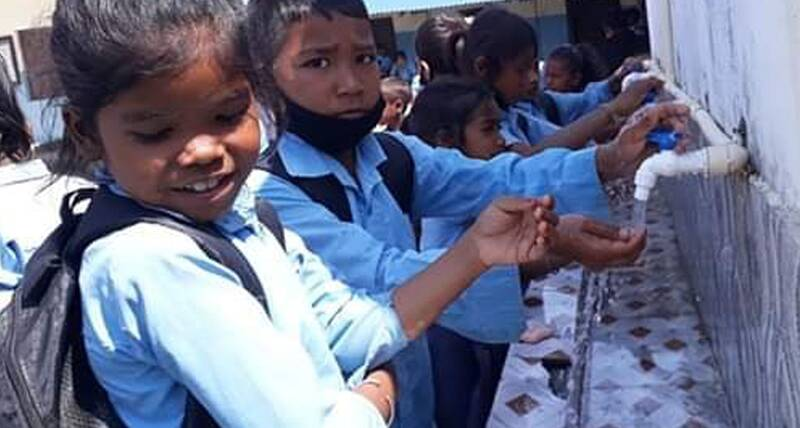 School children practicing proper hand washing at their school in Gaurigunj, Jhapa, Nepal