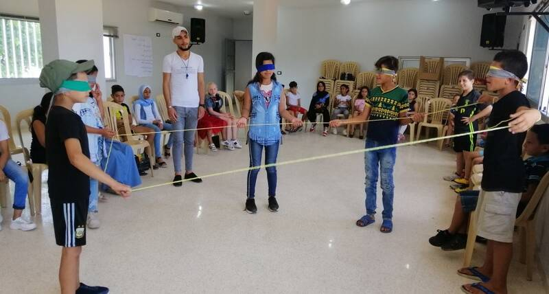 Children in a community centre in El Maachouk in Tyre, Lebanon participate in a team building activity