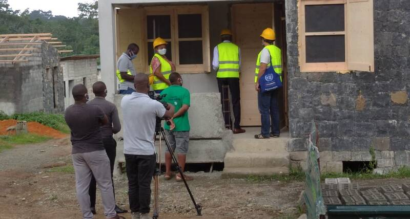 Workers on site at the housing project in Principe