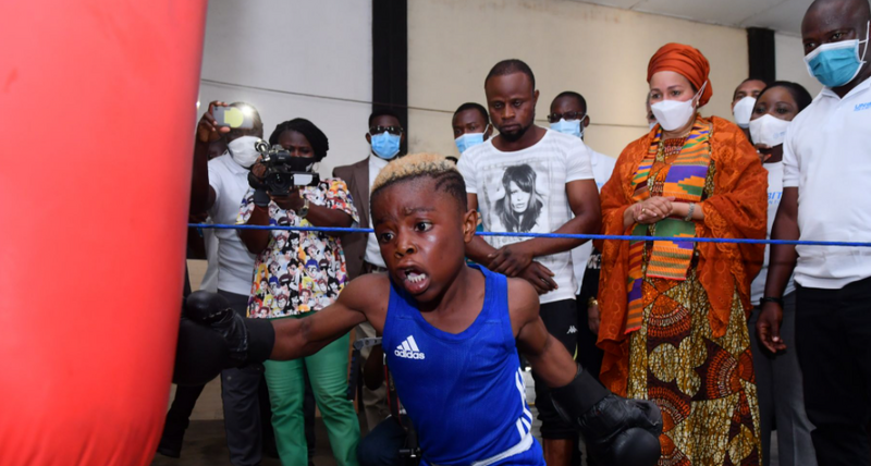 The United Nations Deputy Secretary-General Amina J. Mohammed watches children training at a boxing gym in an informal settlement in the Ghanaian capital Accra