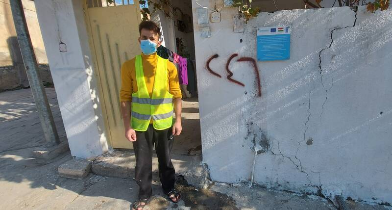 Saud Hussein, a young IDP standing in front of his rehabilitated house in Duhok, Iraq where he proudly worked as a painter through a project implemented by UN-Habitat (3 December 2020)