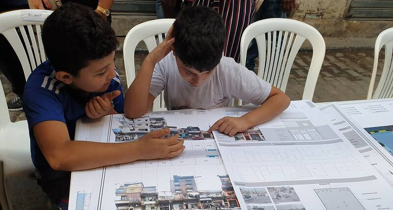 Children from Maraach neighbourhood participate in the community consultation session in 2019