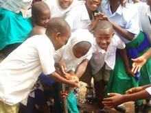 Students of Milimani A,B,C,and D access clean water from a tap